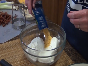 Kristi adds Rada Bacon Cheddar Quick Mix to sour cream.
