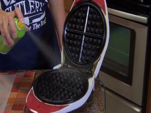 Kristi seasons a waffle iron.