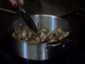 Jess cooks mushrooms in a pan.