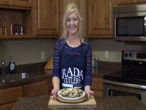 Jess poses with a completed spinach and mushrooms dish.