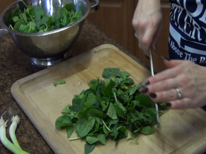 Jess chops spinach with a Rada French Chef knife.