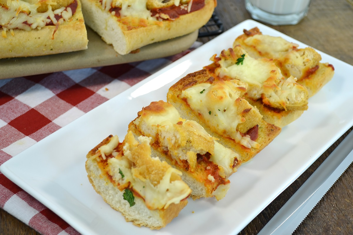A delicious, easy chicken strip pizza made with Rada Cutlery products.