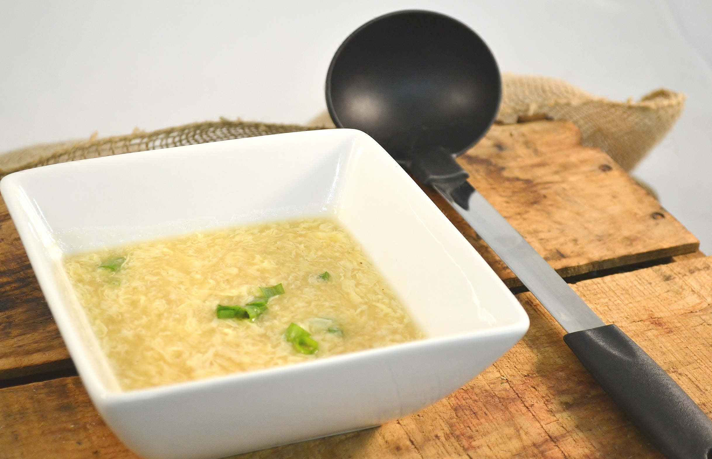 A delicious bowl of homemade egg drop soup with a Rada Soup Ladle.