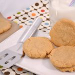 A plate of delicious flourless peanut butter cookies alongside a Rada Spatula.