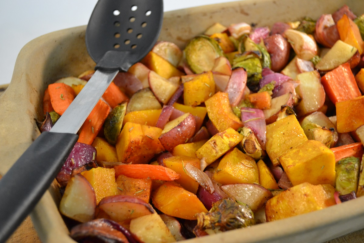 A lovely dish of roasted vegetables in a Rada Rectangular Baker with a Rada Cook's Spoon w/Holes