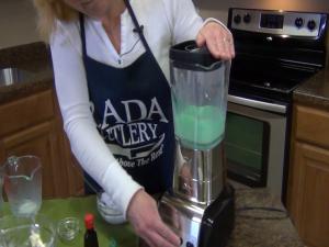 Kristi activates the blender, pulverizing the already soft ice cream.