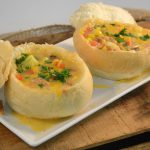 A delicious Southwest Corn and Ham Chowder in bread bowls.