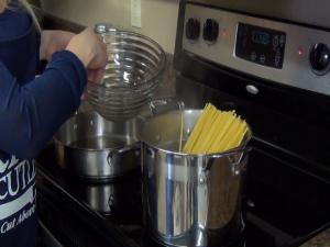 Jess boils her organic gluten-free linguine noodles.