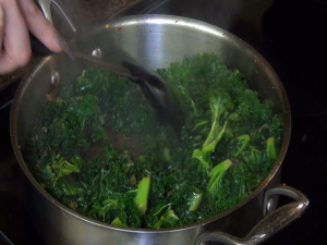 Jess mixes spinach with a Rada Non-Scratch Spoon.