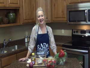 Jess poses with ingredients while wearing a Rada Cutlery apron.