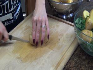Jess uses the Rada Super Parer to quarter potatoes.