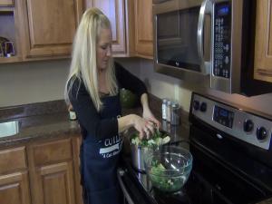 Jess cooks vegetables.