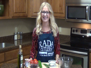 Jess poses with Greek salsa ingredients.