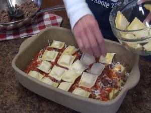 Kristi adds more ravioli.