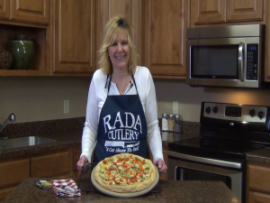 Kristi poses with completed Spinach Artichoke Pizza.