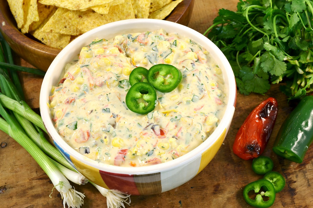 A delicious bowl of sweet roasted pepper corn dip made with Rada Cutlery products.
