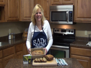 Kristi poses with completed banana bread.