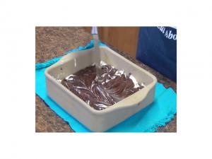 Kristi spreads chocolate mixture.