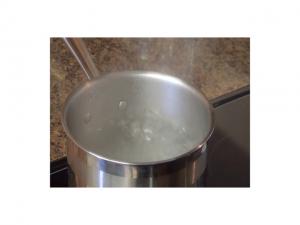 Kristi boils water.