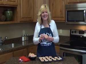 Kristi poses with completed cherry pinwheel cookies.
