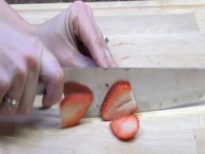 A Rada French Chef chops strawberries.
