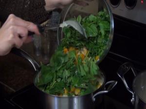 Jess puts spinach in gnocchi sauce.