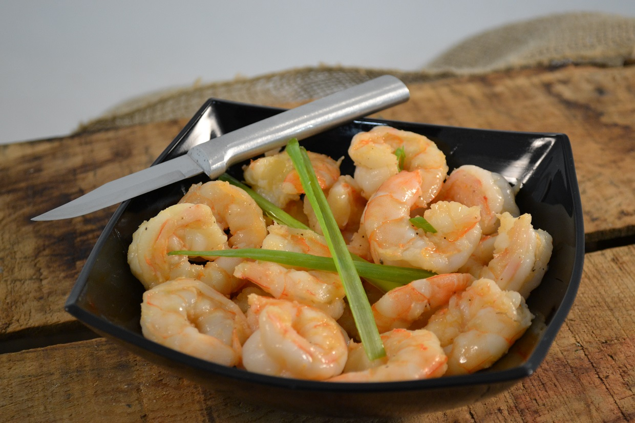 A plate of shrimp with a Rada Peeling Paring knife.