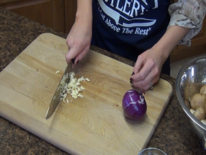 Jess chops garlic and onion with the Rada French Chef knife.
