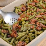 A dish of Arkansas Green Beans with a Rada Cook's Spoon w/Holes.