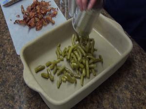 Kristi places green beans in Rada Rectangular Baker.