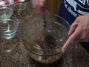Kristi stirs sauce mixture.
