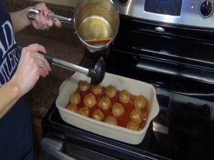 Jess ladles on sauce with the Rada Non-Scratch Soup Ladle.