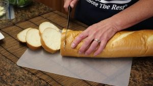 "Kristi uses a Rada 10"" Bread Knife to cut bread."