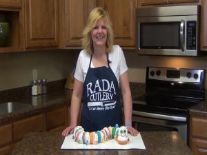 Kristi poses with completed caterpillar cupcake cake.