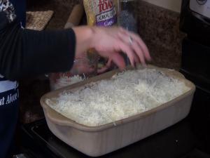 Jess adds cheese to Rada Rectangular Baker.