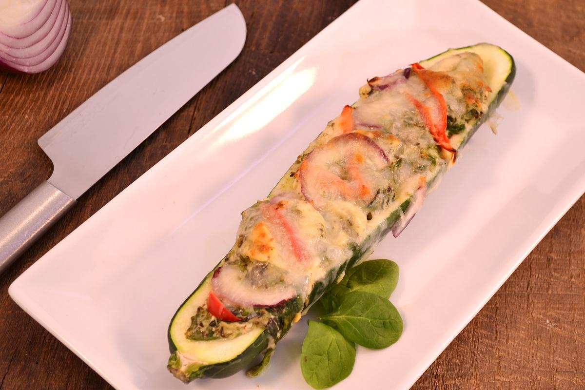 A chicken pesto zucchini pizza boat with a Rada Cook's Knife.