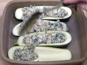 Filling is placed in zucchinis in a Rada Square Baker.