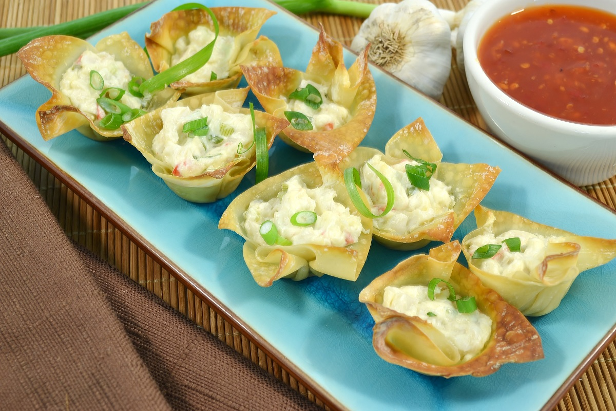 A plate of delicious crab wontons baked in the oven.