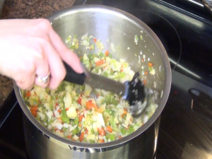 Jess stirs ingredients with a Rada Non-Scratch Spoon.