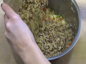 Jess combines rice and vegetables.