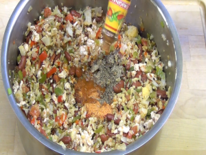 Jess adds spices and hot sauce.