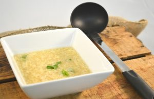 A delicious bowl of egg drop soup with a Rada Non-Scratch Soup Ladle.