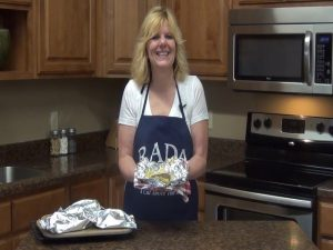 Kristi poses with completed foil packet sausage breakfast.