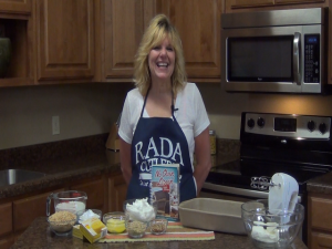 Kristi poses with lemon pudding cake ingredients.