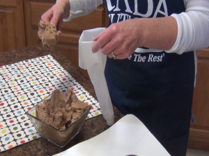 Kristi prepares a frosting bag.