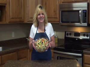 Kristi poses with a completed Pantry Pasta Salad.