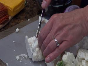 Kristi cuts cauliflower with the Rada Super Parer.