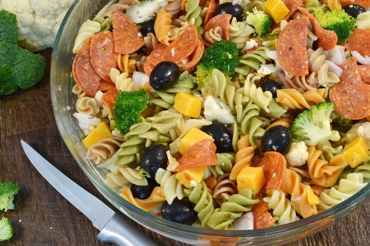 A bowl of delicious Pantry Pasta Salad alongside a Rada Super Parer.