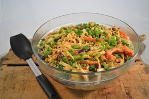 A beautiful bowl of rainbow Thai noodles with Rada products.