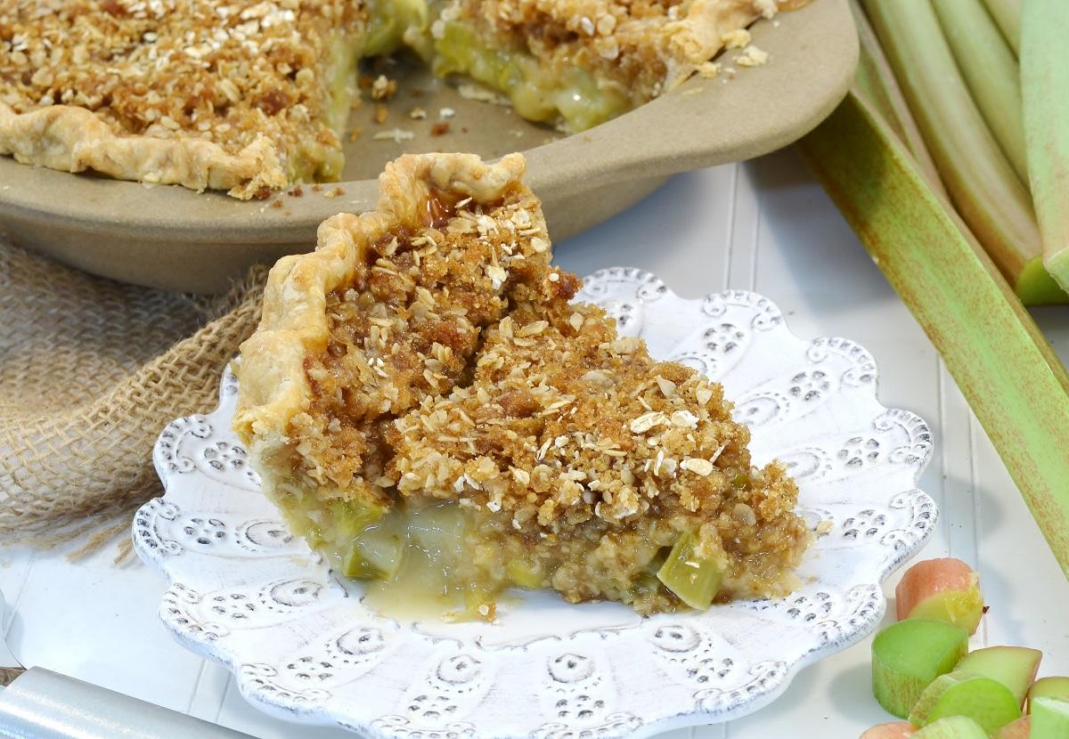 A slice of rhubarb custard crumble pie with a Rada Rectangular Baker stoneware dish.